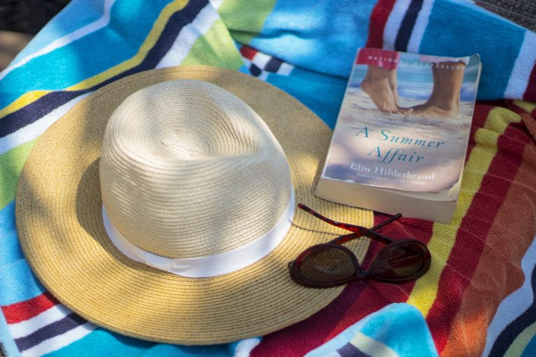 Sunscreen is not the only thing you should have at the beach; a Good Book is also a must!